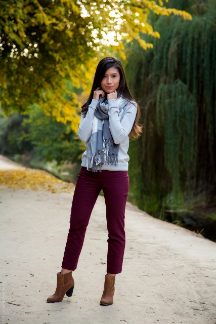 With plaid scarf and brown ankle boots