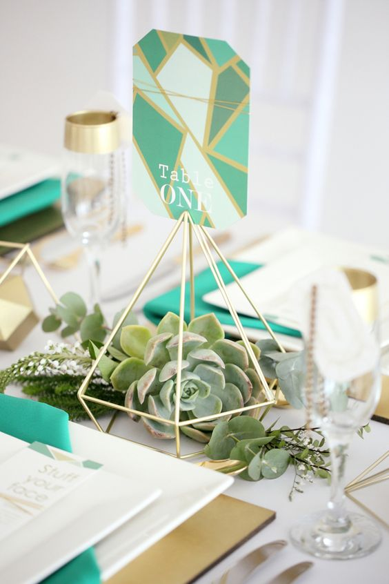 gold straws diamond table numbers with succulents inside