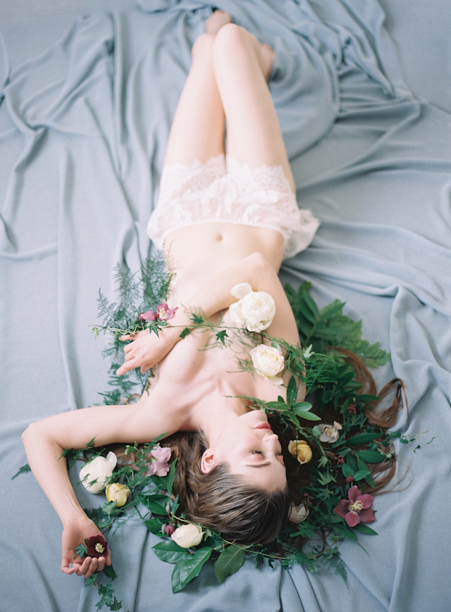 Bridal boudoir in bed with flowers | Carrie King Photographer