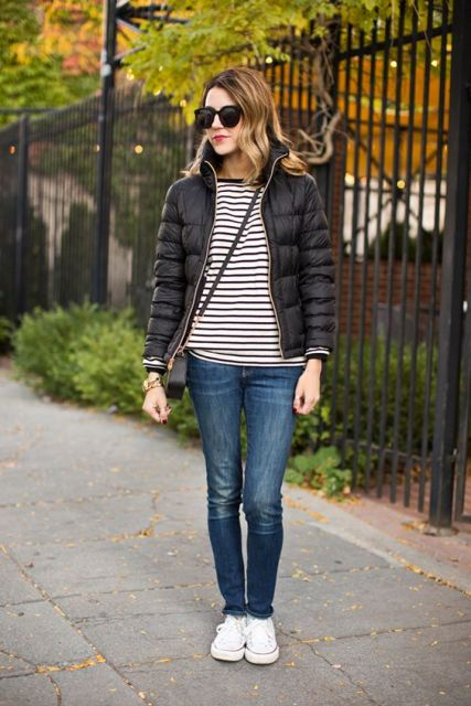 With striped shirt, jeans and sneakers