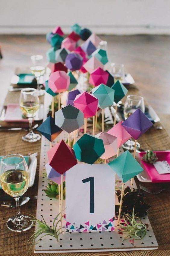 colorful folded paper table runner for a geometric tablescape