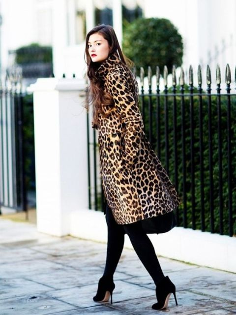 Feminine look with black dress, black tights and ankle boots