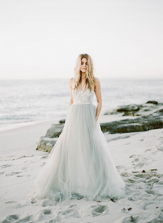 bridal separate with a tulle grey skirt and a white lace top