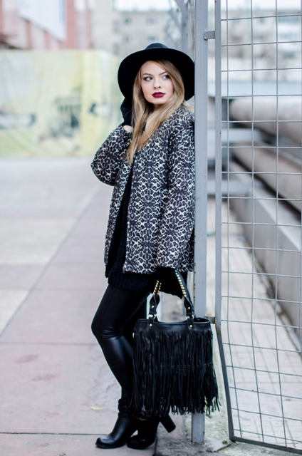 With wide brim hat, fringe bag and leather boots