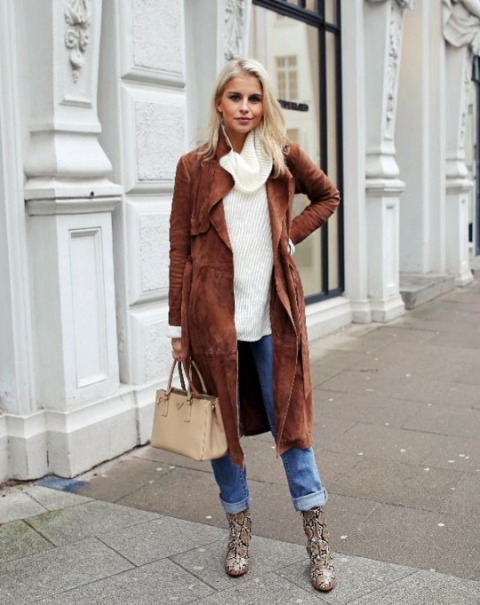 With white sweater, cuffed jeans and animal printed boots