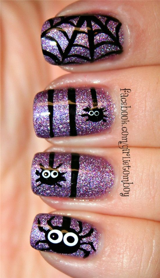 glitter purple nails with funny spider decals