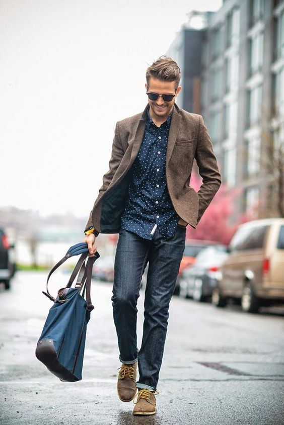 dark jeans, a dotted shirt and brown shoes