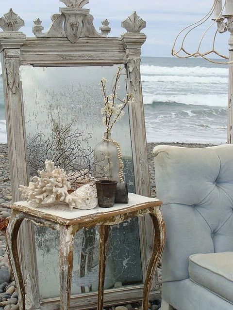 wintry seaside decor with a vintage mirror and corals