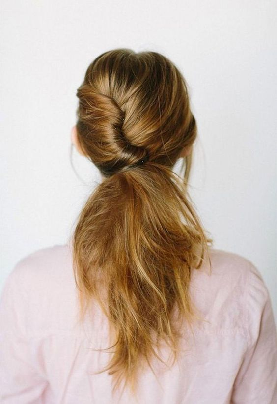 low messy ponytail with a twist