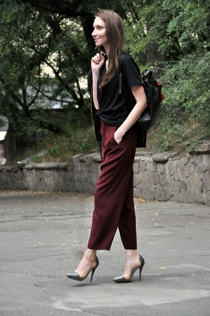 With loose black shirt and high heels