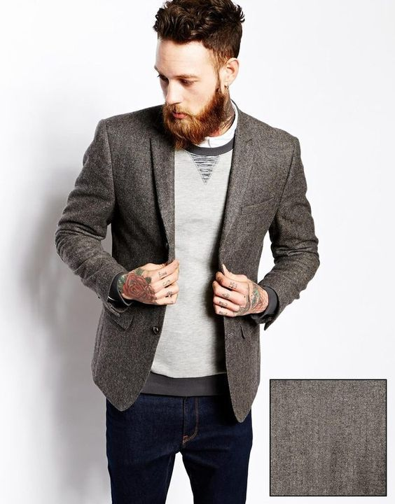 navy denim, a light grey jumper and a tweed jacket