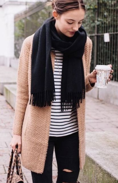 With black scarf, striped shirt and distressed jeans