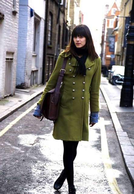 With leather bag, black tights and ankle boots