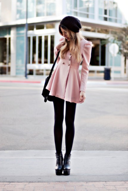 With mini skirt, black tights, platform ankle boots and bag