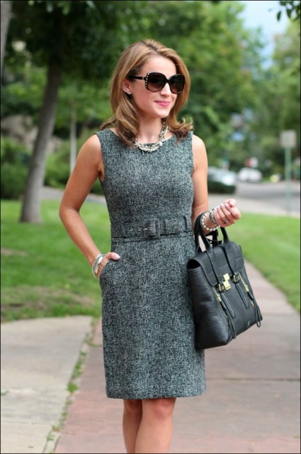 With black leather bag, oversized sunglasses and elegant necklace
