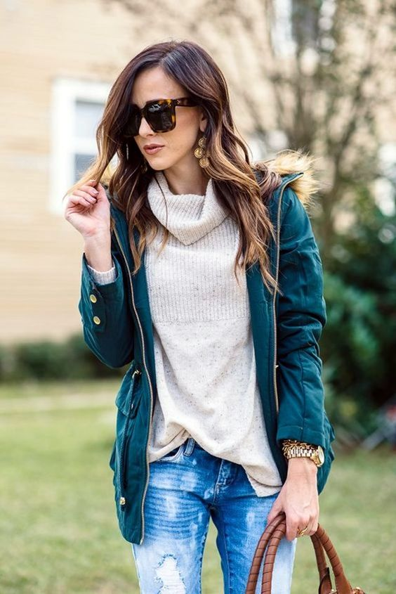 distressed denim, a neutral turtleneck and an emerald coat