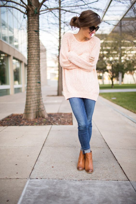 jeans, an oversized blush sweater and boots