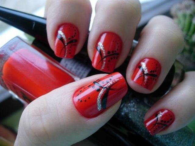 hot red nails with an eye-catchy design