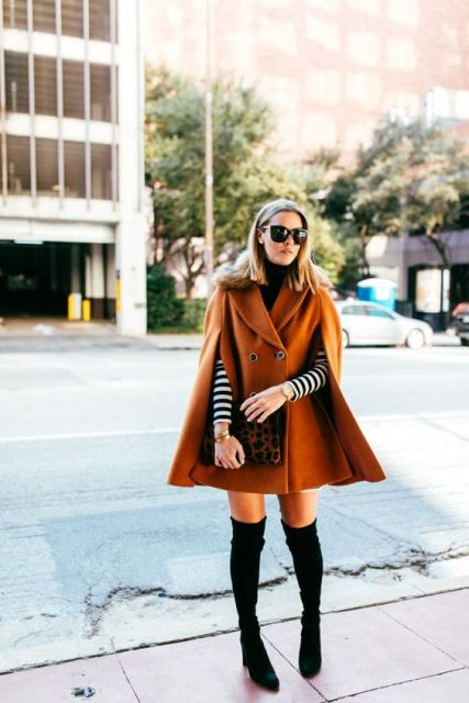 With striped shirt, over the knee boots and leopard clutch