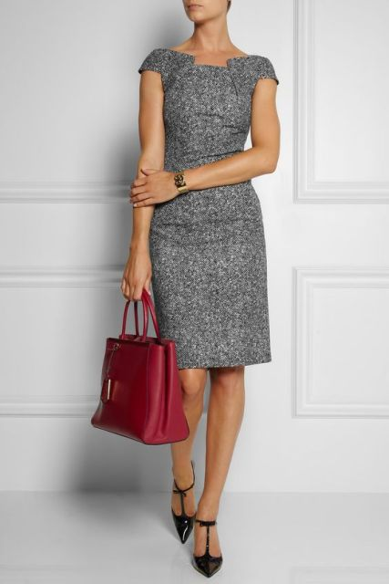 With leather black shoes and red bag