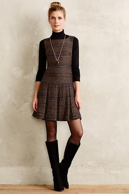 With turtleneck, necklace and high boots