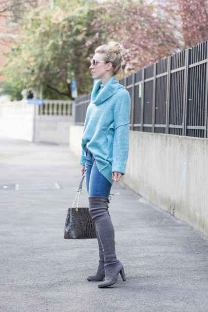With loose bright color sweater and leather bag