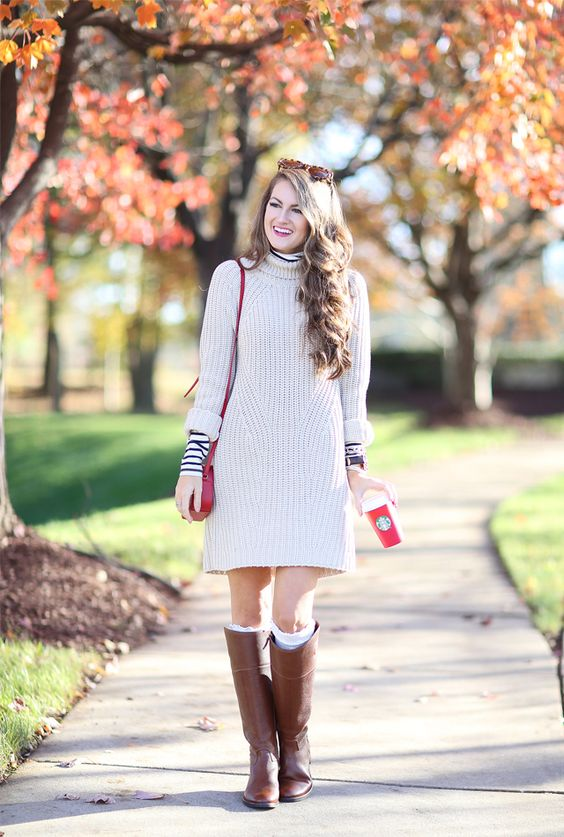 cream sweater dress, high boots and leg warmers