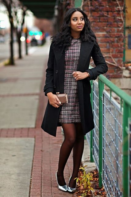With black coat, metallic shoes and black tights