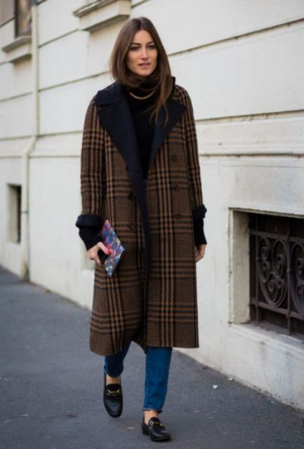 With classic jeans, black turtleneck and loafers