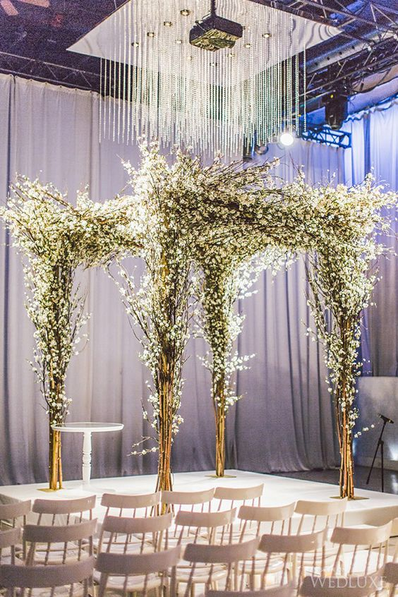 ceremony canopy made of branches and white flowers to make your winter nuptials solemn