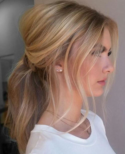 sweep hair into a low ponytail and let pieces fall out on the sides