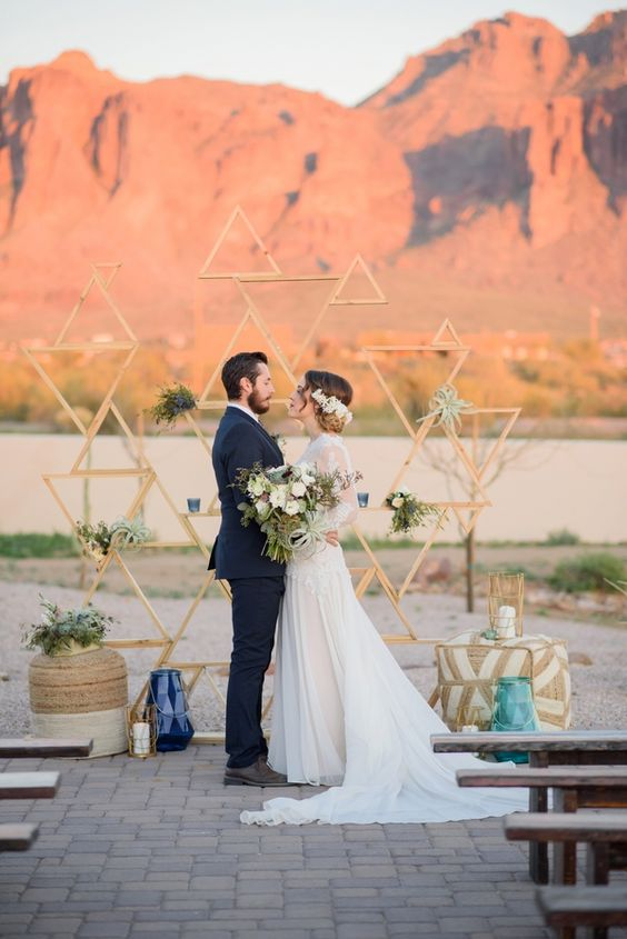 wooden plank triangle backdrop for a desert wedding