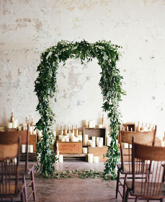 green leaves and some small white flowers on top is a cool idea for every indoor ceremony