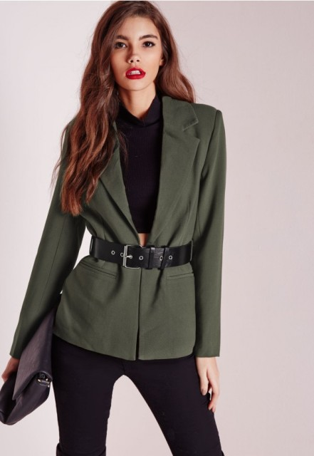 With black crop top and trousers