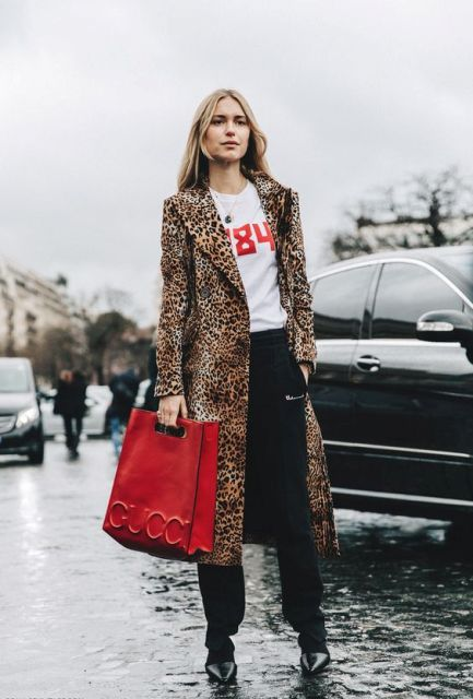 With black trousers and big red bag