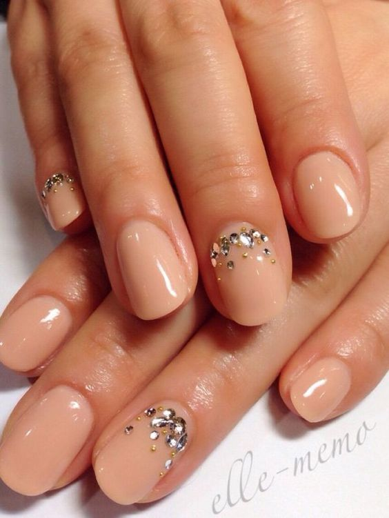 nude nails with rhinestone accent nails