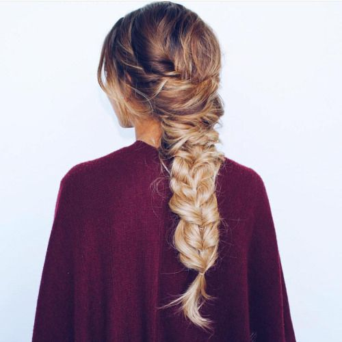 large messy back braid with a twist