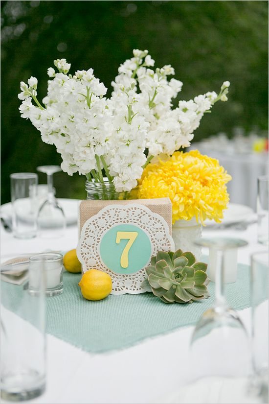 mint fabric and table number on a doily, yellow lemonds and flowers