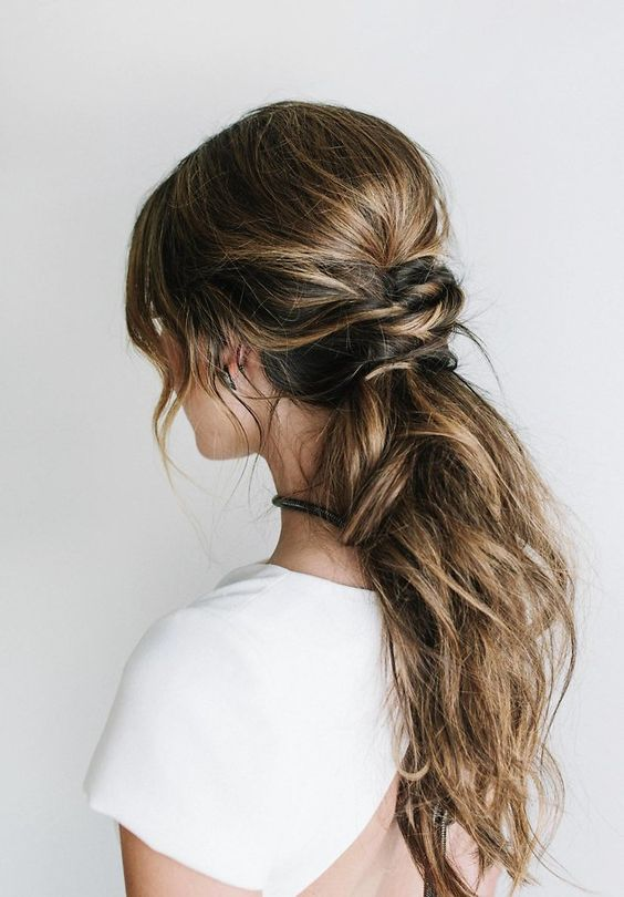 messy low ponytail for hair with lowlights