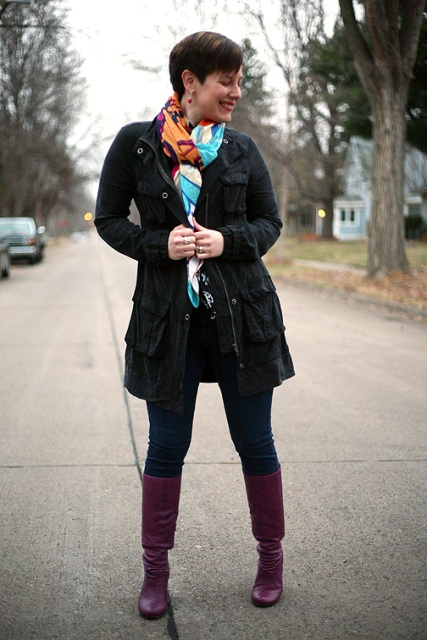 With colorful scarf, black coat and jeans