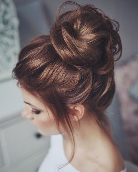 messy hair top knot for a wedding