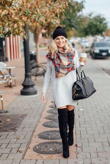 With oversized sweater, plaid scarf and over the knee suede boots