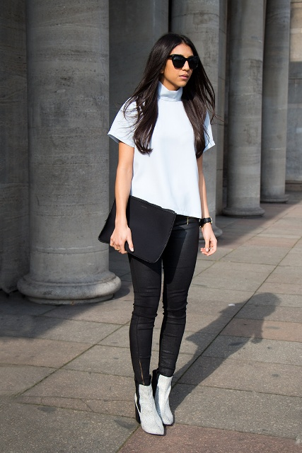 With white shirt and skinny black trousers