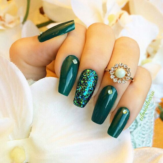 green nails and an accent green sequin nail looking as a mermaid tail