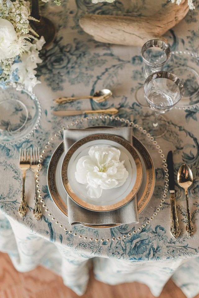 Charger plates with china and toile tablecloth | About Time Photography