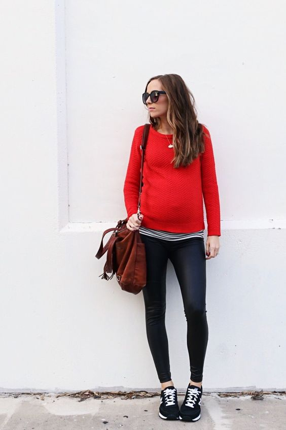 mom-to-be style with a red sweater, a striped shirt and chucks