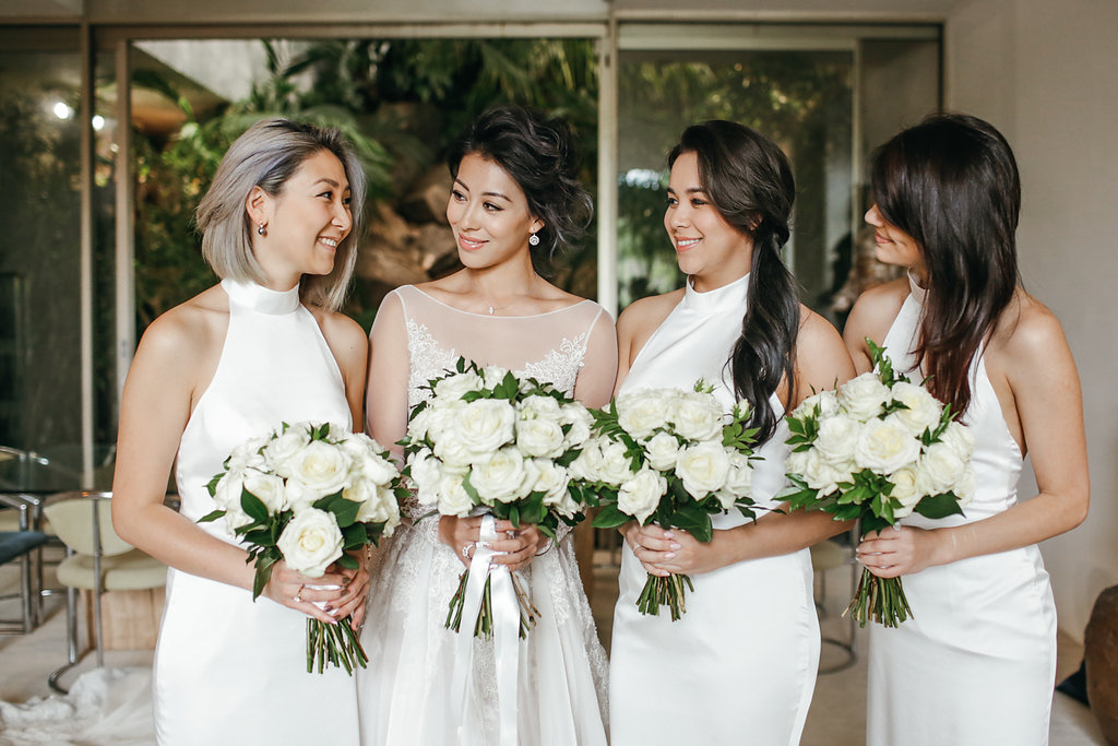 bridesmaids in white - photo by Lara Hotz http://ruffledblog.com/secret-garden-inspired-australian-wedding