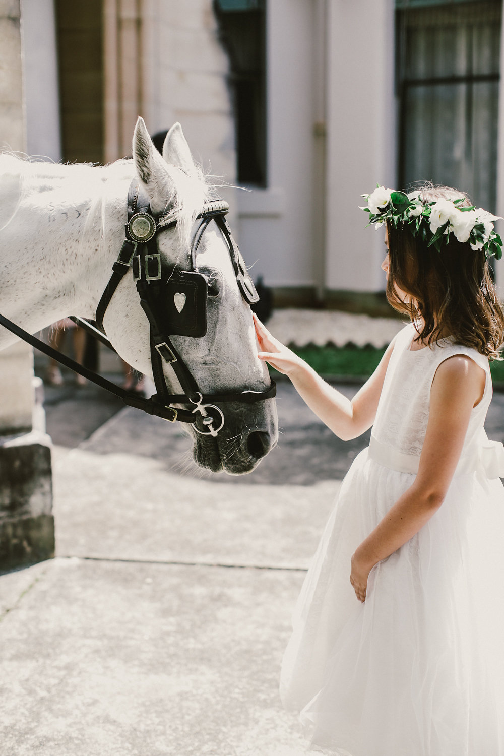 flower girl petting horse - photo by Lara Hotz http://ruffledblog.com/secret-garden-inspired-australian-wedding