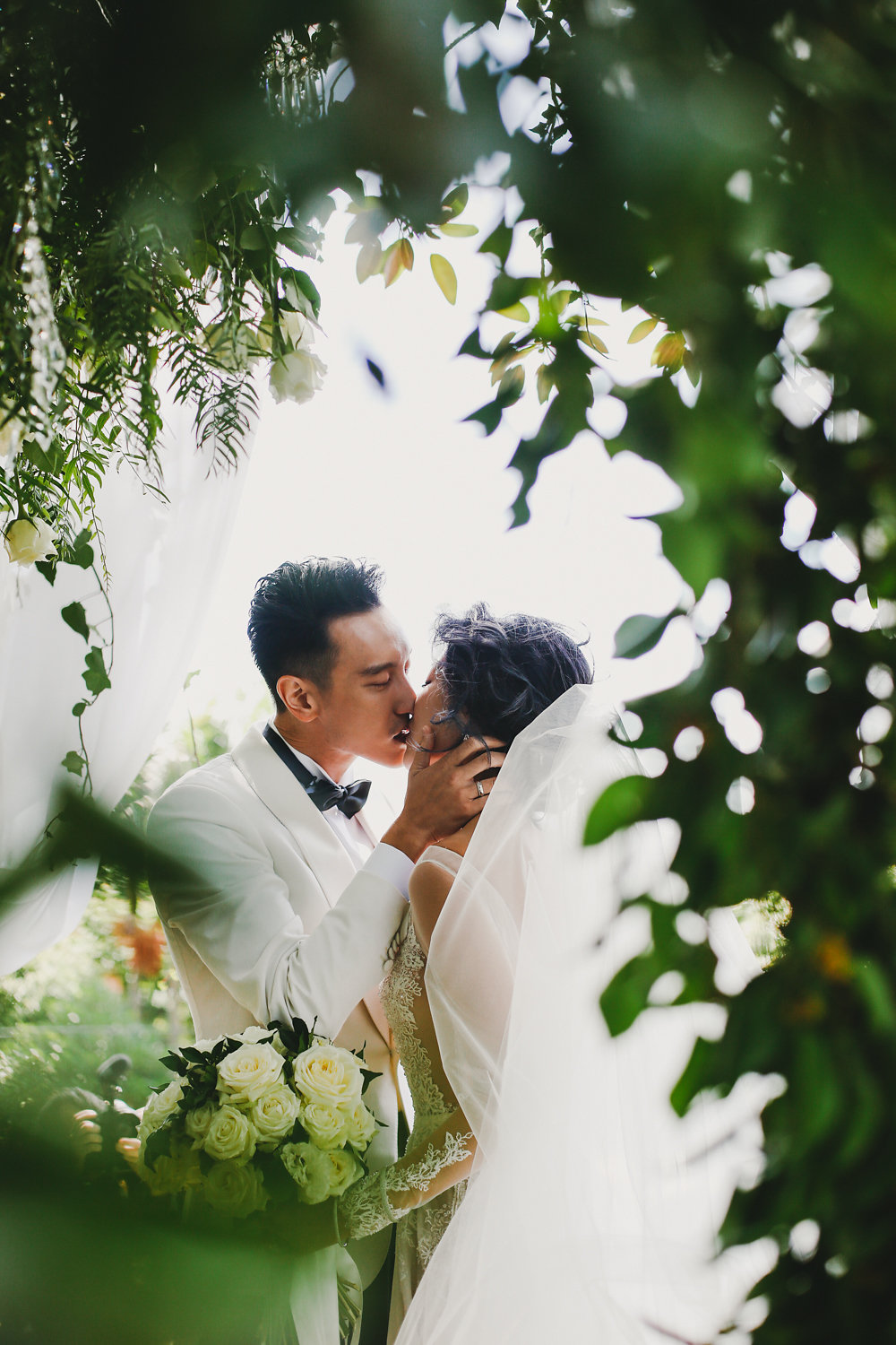 ceremony kiss - photo by Lara Hotz http://ruffledblog.com/secret-garden-inspired-australian-wedding