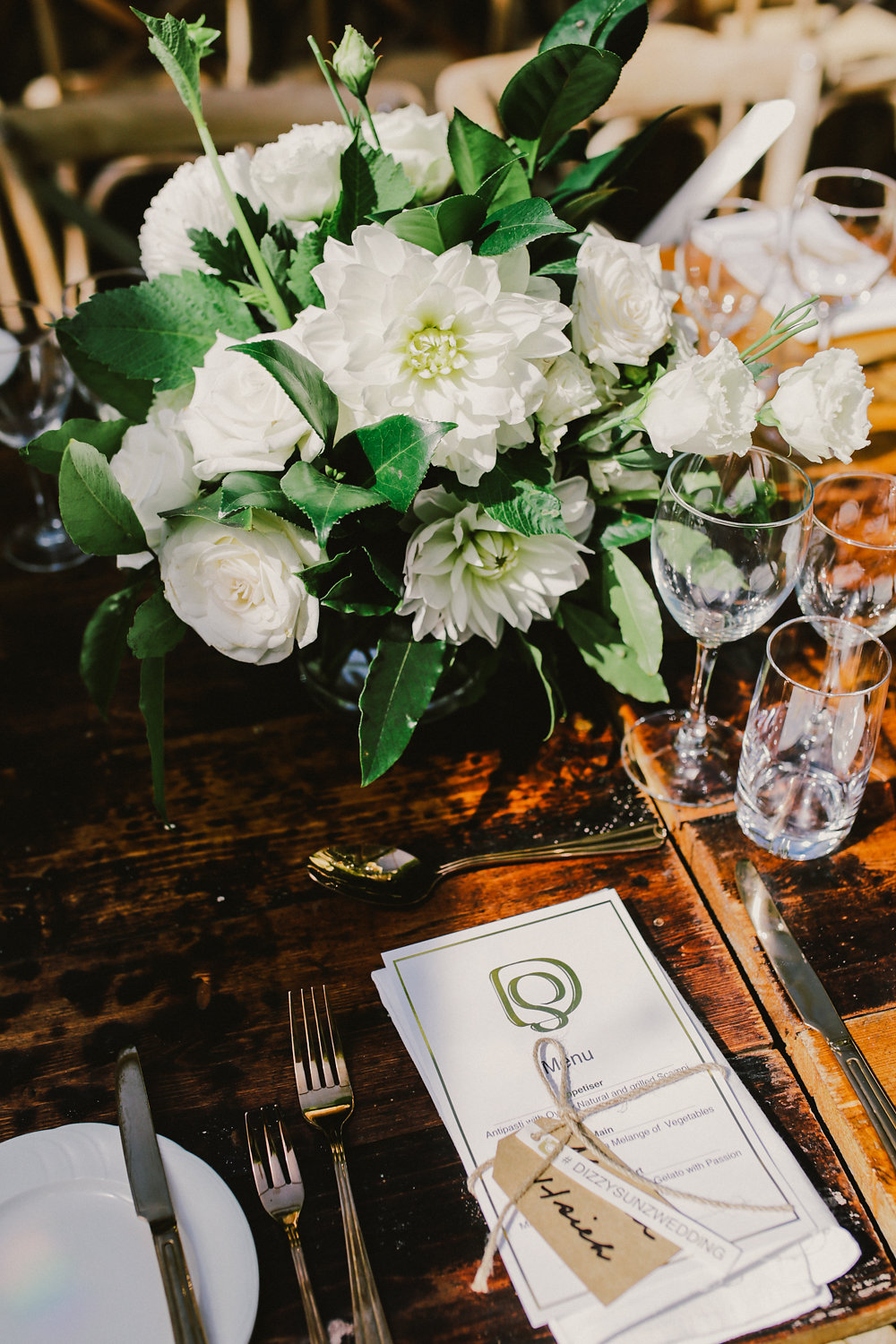 garden wedding place setting - photo by Lara Hotz http://ruffledblog.com/secret-garden-inspired-australian-wedding